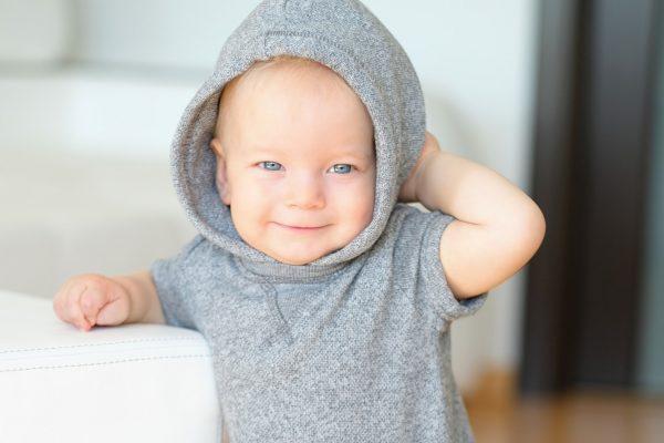 Baby boy with blue eyes wearing hoodie