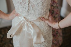 Woman Wearing Beige Lace Gown With Bow Belt Photo